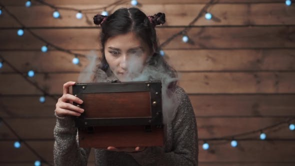 Thumbnail for A Woman Opening a Magic Gift Box At Xmas