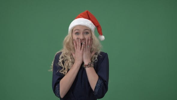 Thumbnail for Woman In a Red Christmas Cap Looking Surprised