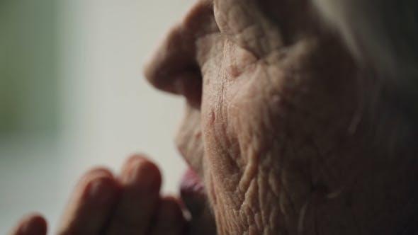 Thumbnail for Old Woman Praying