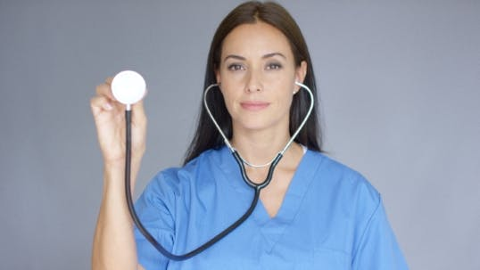 Thumbnail for Attractive Doctor Holding Up a Stethoscope