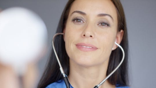 Thumbnail for Attractive Young Nurse Using a Stethoscope