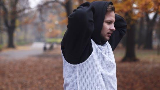 Thumbnail for fitness mann tun dehnen übungen outdoor Young Man Fitness Workout Outdoor