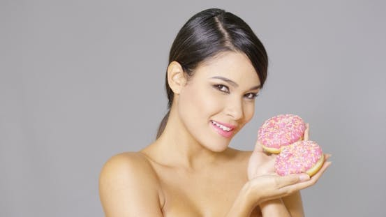 Thumbnail for Gorgeous Smiling Woman Holding Donuts