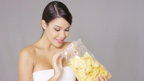Happy Woman Grabbing Potato Crisps