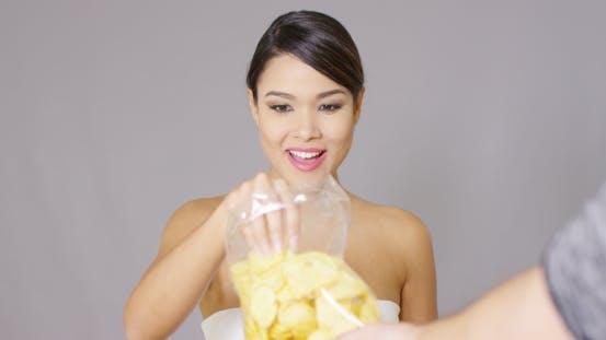 Thumbnail for Happy Woman Grabbing Potato Crisps