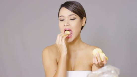Thumbnail for Attractive Young Woman Enjoying a Potato Crisp