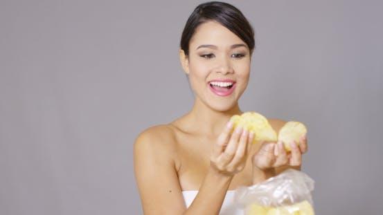 Thumbnail for Laughing Young Woman Eating Potato Crisps