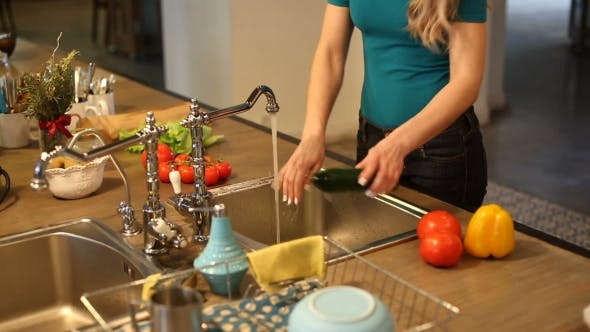 Thumbnail for Young Woman Washing Vegetables