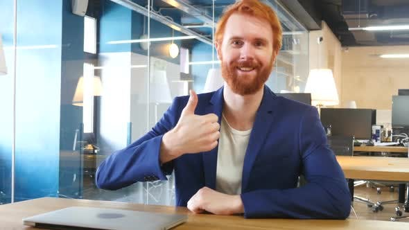 Cover Image for Thumbs Up by Man in Office, Red Hairs