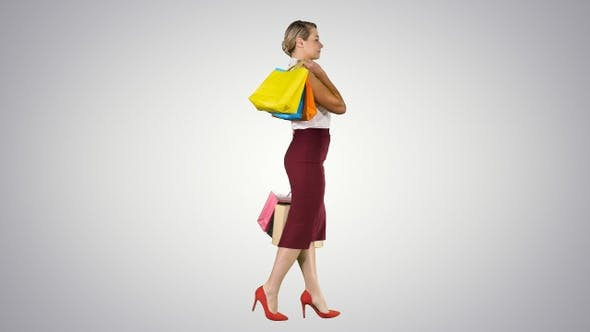 Thumbnail for Happy shopping! Womanholding multicolored shopping bags
