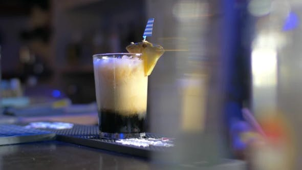 Thumbnail for Barman Putting Straws Into Glass With Cocktail