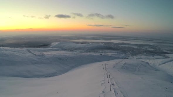 Flying Over the Snowfield in the Evening