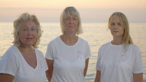 Three Women with Pink Breast Cancer Awareness Ribbons