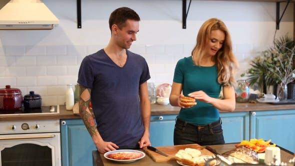 Thumbnail for Man and Woman Making Hamburgers