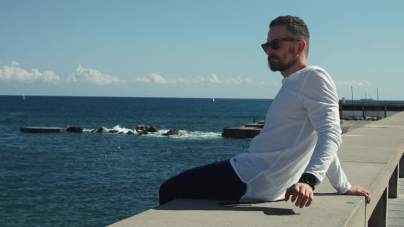 Thumbnail for Man Sitting in Front of Sea in Sunny Day