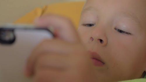 Child Entertaining with Smart Phone