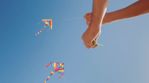 Thumbnail for Hands of a Man Control a Kite. Precise Control Concept