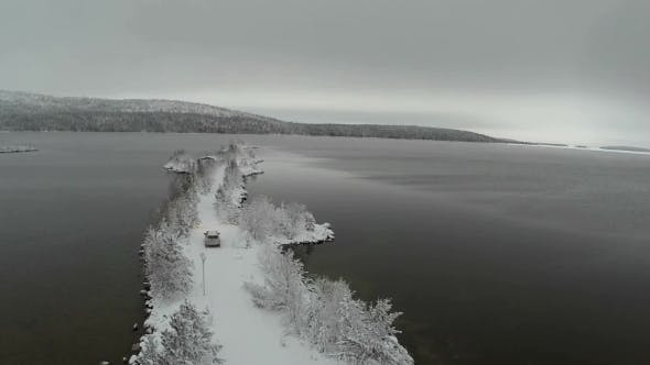 Thumbnail for Car Driving on Winter Island Road in the River, Aerial View