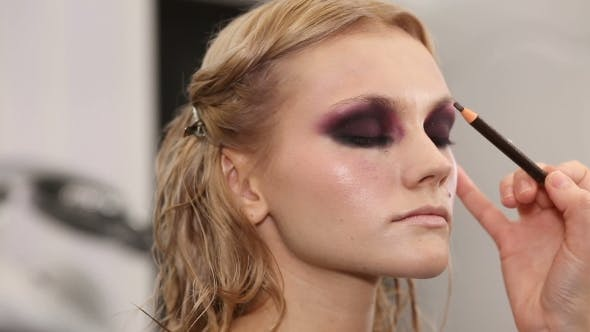 Thumbnail for Professional Makeup Artist Putting Cosmetics on Model Face