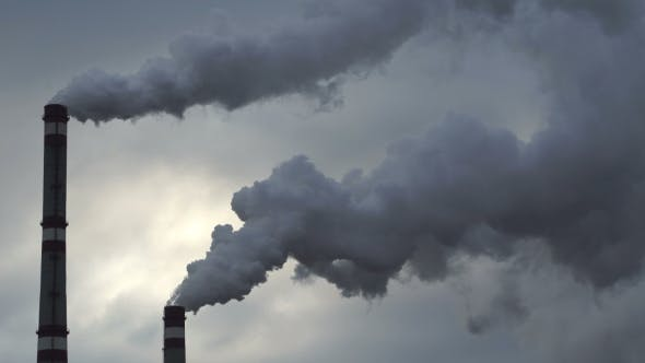 Thumbnail for Footage Industrial Chimneys Emits Toxic Pollutants Into The Sky Polluting The Environment.