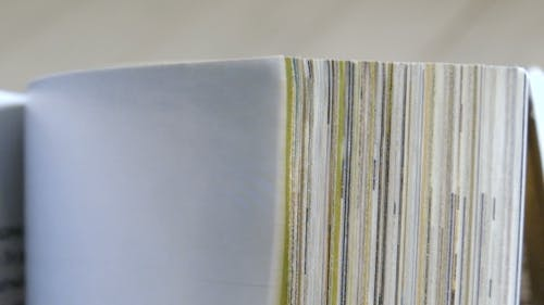 Turning Pages of a Magazine.