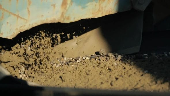 Thumbnail for Gravel Poured From Dosing Device Rotary Crusher To Conveyor Belt.