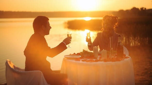 Cover Image for Young Couple Share a Romantic Dinner on the Beach