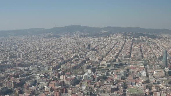 Thumbnail for Barcelona Wide Drone Shot of City Towards Center with La Sagrada Familia and Torre Glories