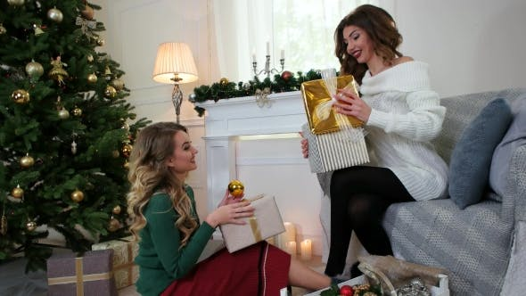 Cover Image for Packaging Presents, Girlfriends Are Preparing for the New Year Holiday, a Christmas Surprise, Women