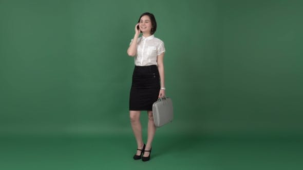 Thumbnail for Nice Brunette Woman in Business Clothes Talking on the Phone