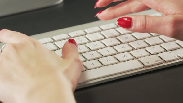 Thumbnail for Woman Typing on a Keyboard and Making Gestures