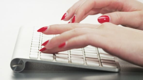 Thumbnail for Woman Typing on a Keyboard