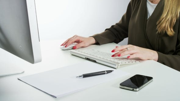 Thumbnail for Woman Using Mouse and Typing on a Keyboard