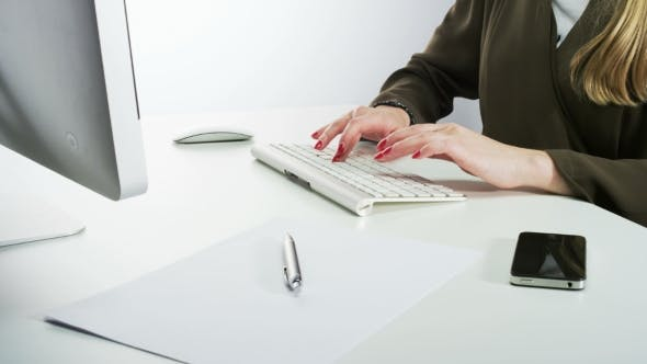 Cover Image for Woman Typing on a Keyboard