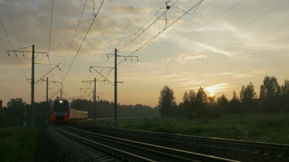 Thumbnail for Passenger Train in Rural Area at Sunset
