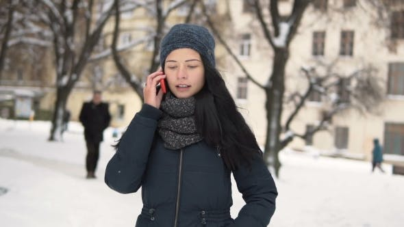 Young Brunette Girl Talking By Phone