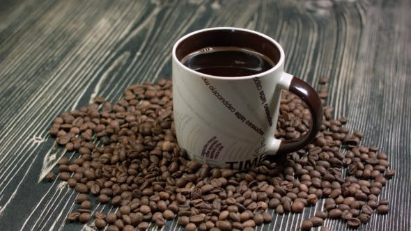 Top View of Coffee Cup on a Wood Background with Copy Space