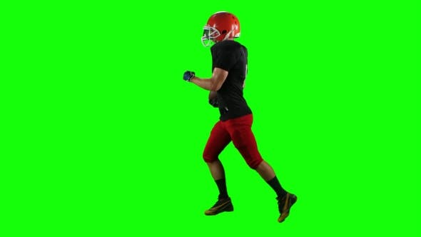 Thumbnail for Football Player Running with the Ball in His Helme