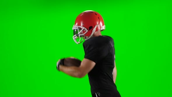 Thumbnail for Young Boy Playing Football in a Red Helmet. Green Screen