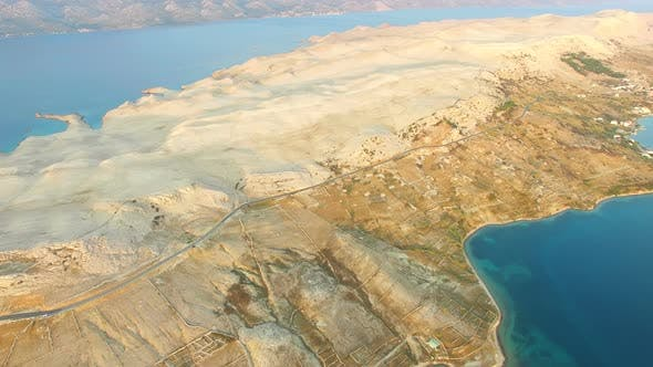 Thumbnail for Aerial view of road through barren landscape of Pag island in Croatia