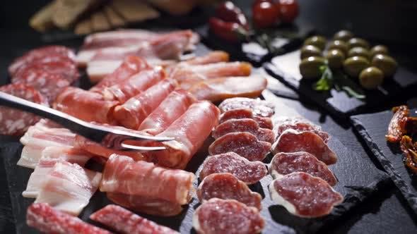 Salami and Chorizo Sausage Close Up on Stone Serving Board