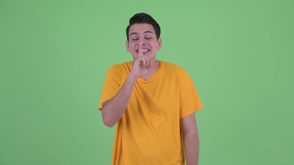 Thumbnail for Happy Young Multi Ethnic Man with Finger on Lips