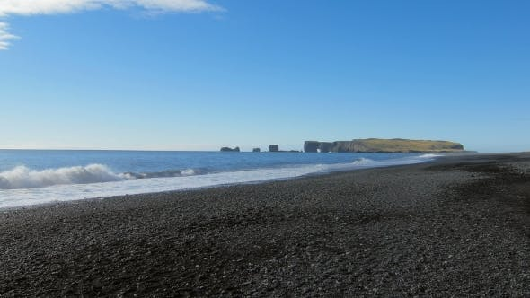 Thumbnail for View of Cape Dyrholaey From Black Sand Beach in Iceland in Sunny Calm Weather