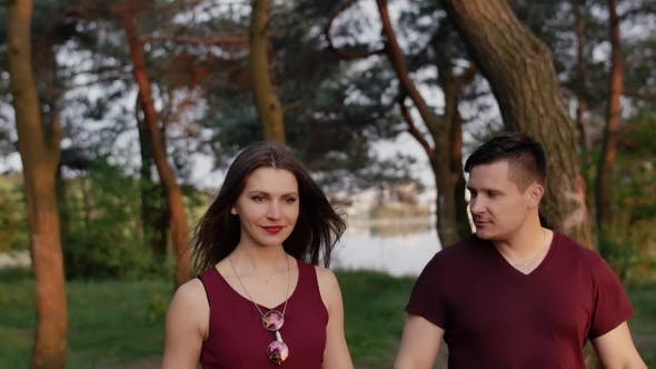 Thumbnail for Beautiful Brunette Couple Walk in Nature, Smile, Enjoy Time Together. They Look Happy and Glad