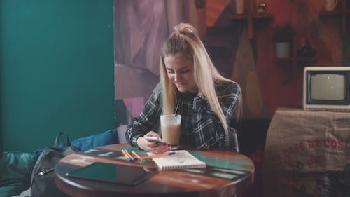 Girl in Cafe Uses a Wi-fi for SMS, Social Networks.