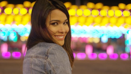 Thumbnail for Smiling Young Woman at a Colorful Fairground