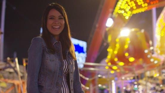 Thumbnail for Vivacious Young Woman at an Evening Funfair