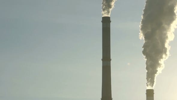 Thumbnail for Footage Industrial Chimneys Emits Toxic Pollutants Into the Sky Polluting the Environment