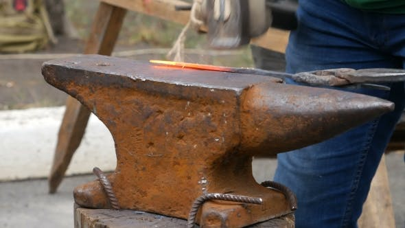 Thumbnail for Blacksmith Working on Metal on Anvil