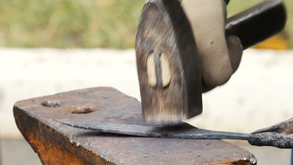 Cover Image for Blacksmith Working on Metal on Anvil